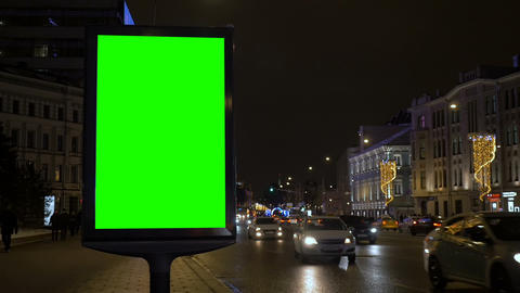 Time lapse. A billboard with a green screen on a busy festive street GIF
