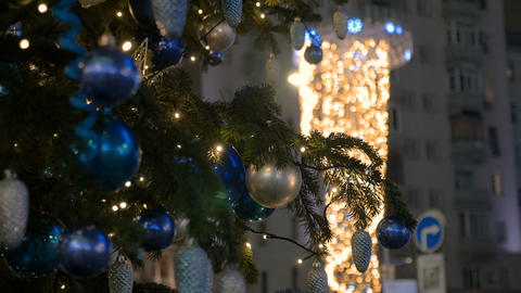 Christmas decoration balls hanging on tree on the background lights garland Footage