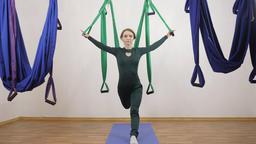 Young caucasian woman making antigravity fly yoga exercises in hammock in studio 영상물