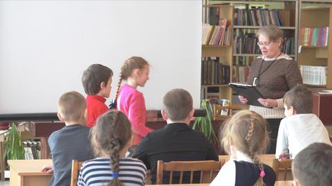 School kids of elementary school in the classroom Live Action