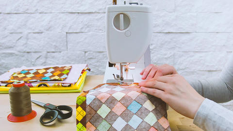 woman sews on a sewing machine Footage