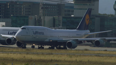Lufthansa's jumbojets taxiing in Frankfurt airport Footage