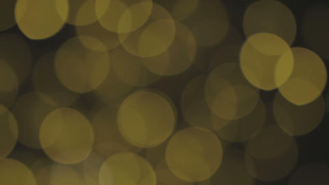 Golden, blurred, bokeh lights background. Abstract sparkles. Full HD loop Footage