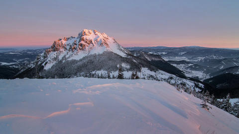 Beautiful sunrise in winter snowy mountains, time lapse, dolly shot Footage