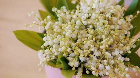 bouquet of lily of the valley on a wooden table Footage