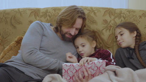 Father read the fairytale to a little daughters Footage