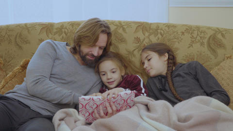 Young father read the fairytale to his little daughters Footage