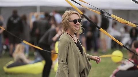 SAINT PETERSBURG, RUSSIA - JULY 16, 2015: Blonde girl in sunglasses posing on Footage