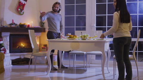 Family sits at the festive christmas table Footage