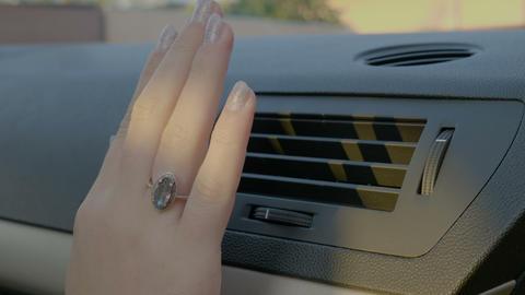 Hand of woman turning ac heat on in car ライブ動画