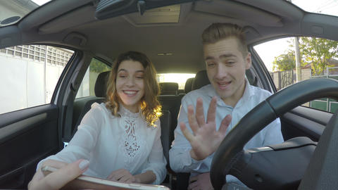Happy young lovers make video call on smart phone in the car Footage