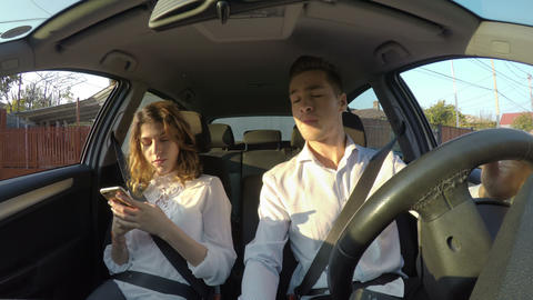 Driver and girlfriend use smart phones and texting while driving and not paying Footage