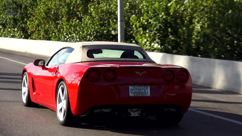 Red corvette driving on a street in Miami – MIAMI, FLORIDA/USA OCTOBER 23, 201 Live Action