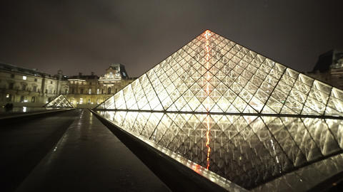 Paris Louvre museum by night - editorial use only Footage