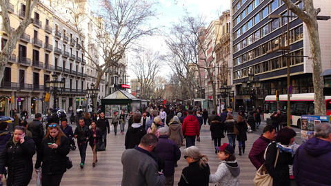 Many People Stroll At Les Rambles, February Weather, Overhead View, Glide Shot stock footage