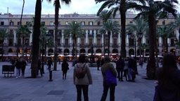 POV camera walk out to Royal Plaza, twilight time, some people stroll around Footage