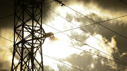 High voltage electrical tower in clear dark at sunset a cloudy day, timelapse Footage