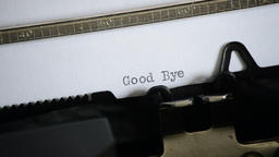 Typing the expression Good Bye with an old manual typewriter Footage