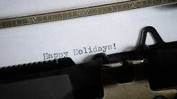 Typing the expression Happy Holidays! with an old manual typewriter Footage