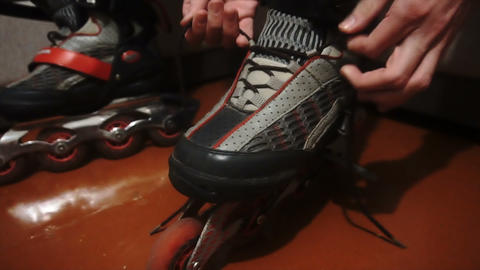 tying of laces on roller skates Live Action
