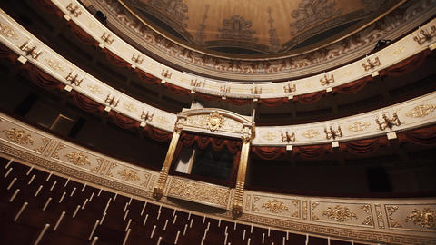 Luxurious balcony in concert hall, empty chairs rows, red draipings Footage