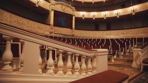 Gorgeous balcony in opera hall, vacant chairs rows, red draipings Footage