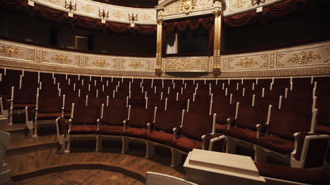 Gorgeous balcony in opera hall, empty chairs rows, red draipings Footage