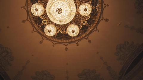 Pompous golden chandelier on opera hall ceiling with murals Footage