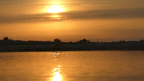 Impressive skyscape with golden sunset on Dzharylhach island in slo-mo Live Action
