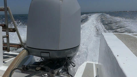 A motorboat engine moves the powerboat in the Black Sea Live Action