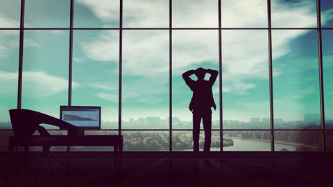 A businessman holds his head in his office when thunderclouds gather around him Animation