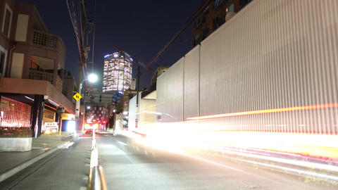 Timelapse of Tokyo night view looking up a modern building from a small alley ビデオ