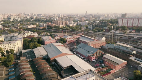 Aerial landscape from flying drone over industrial buildings and urban buildings Live Action