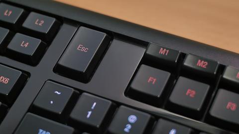 Man pressing ESC key on computer keyboard Live Action