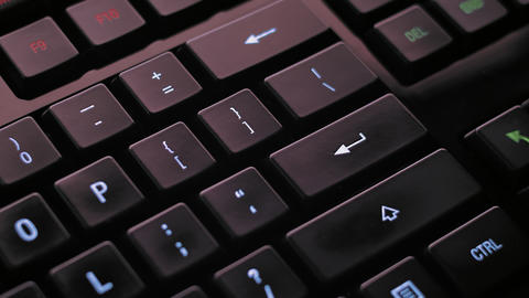 Man pressing enter key on computer keyboard Footage