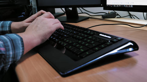 Man typing on computer keyboard Live Action