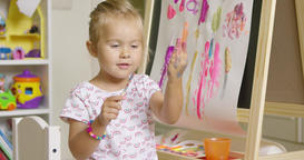 Cute girl artist creating a colorful abstract Footage