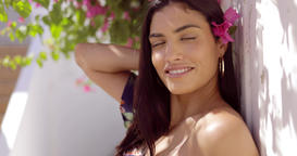 Charming brunette with flowers in hair Footage