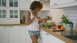 Content woman cooking ad dancing Footage