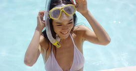 Smiling woman in swim suit wears goggles Footage