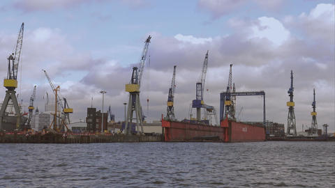 Hamburg harbor container cranes - HAMBURG, GERMANY DECEMBER 23, 2015 Footage
