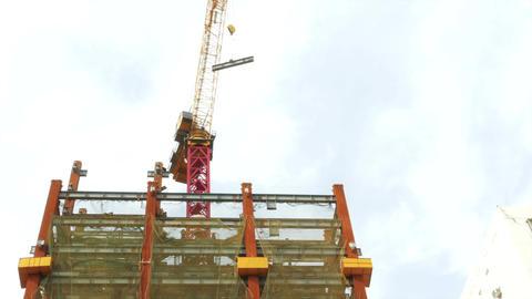 Tower crane swinging I beam around front logos blurred 1 Footage