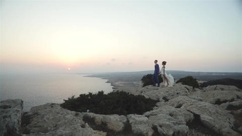 Couple On The Rock In Wedding Dress Footage