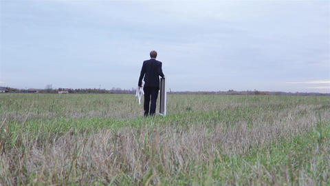 Man With Easel And Canvas In The Field stock footage