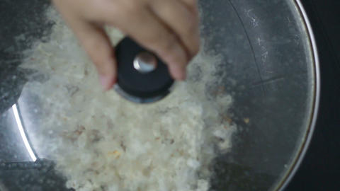 HD Footage of Popcorn cooking in a frying pan Footage