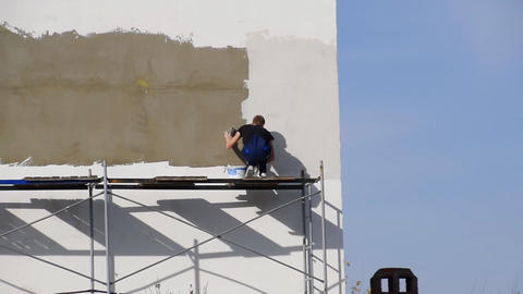 Plasterers Builders plastered wall in a commercial building. Wor Footage