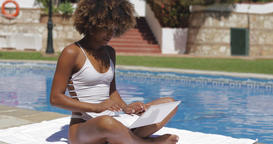 Charming girl with laptop in pool Footage