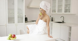 Woman after shower eating apple Footage