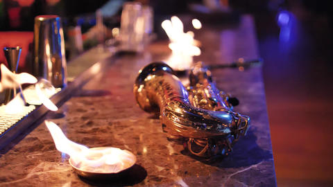 Saxophone and fire on the bar Archivo