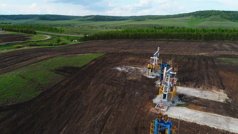 Pumpjacks Extract Oil Liquid out of Drilled Well Footage